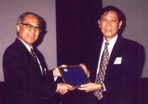 Liao given the HLM award by Liu